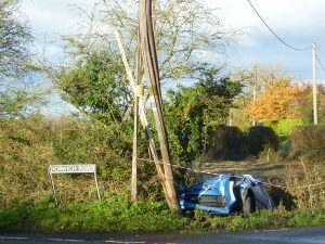 Splintered Telegraph pole & Car